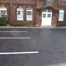 Tarmac driveway with parking lines